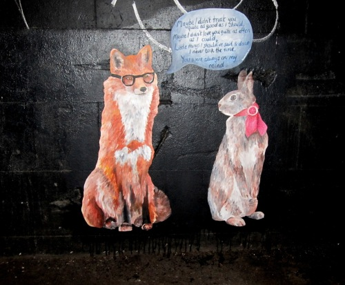 Graffiti on wall of fox and rabbit