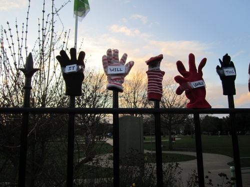 Lonely gloves on park fence - it will be
