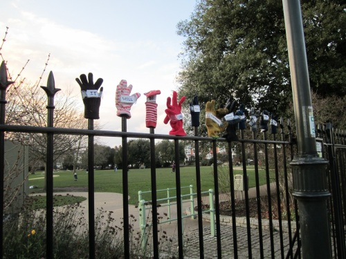 Lonely gloves on park fence